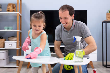 Cute Smiling Daughter Helping His Father For Cleaning The White Stool With Sponge At Home Stok Fotoğraf