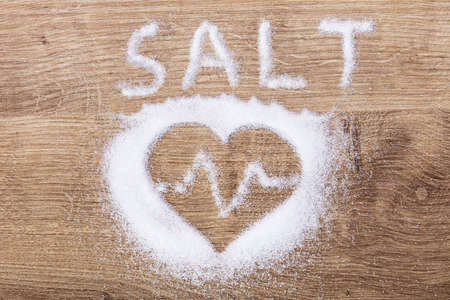 Salt And Heart With Heartbeat Made With Salt On Wooden Desk Stok Fotoğraf