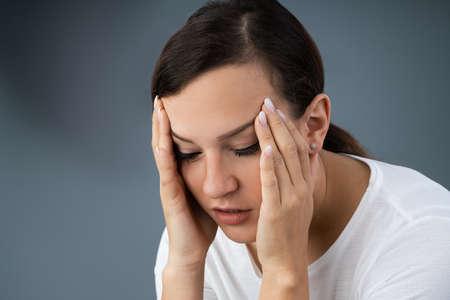 Photo Of Young Woman Suffering From Vertigo illness Фото со стока