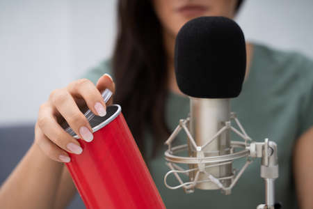 Woman Opening Can On Microphone To Make ASMR Sounds