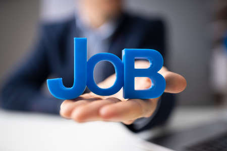 Close-up Of Businessmans Hand Giving Job Text Stok Fotoğraf