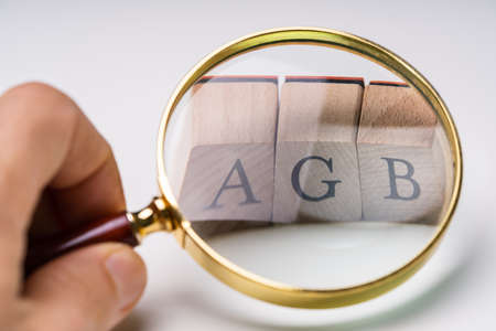 Closeup Of AGB Letters  Under Magnifying Glass. Standard Form Contract In Germany