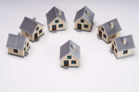 Miniature Houses Showing Standout Concept Isolated Over White Backdrop
