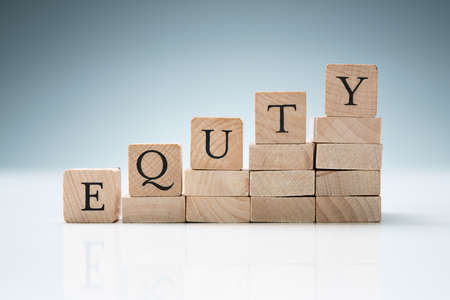 Stack Of Wooden Blocks Arranged In A Row Showing Equity Text Over Reflective Desk Stock fotó
