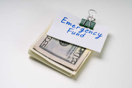 Emergency Fund Text On Card Over The Folded Bundle Of 50 Dollar Notes Stock fotó - 133704643