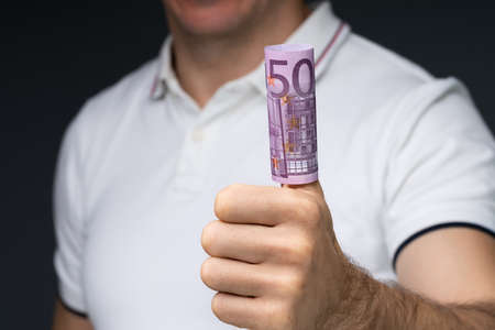Mid Section Of A Man's Hand Showing Rolled Up 500 Euro Notes Over His Thumb Stock fotó - 133704901