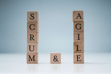 Wooden Scrum And Agile Blocks On Reflective Blue Background