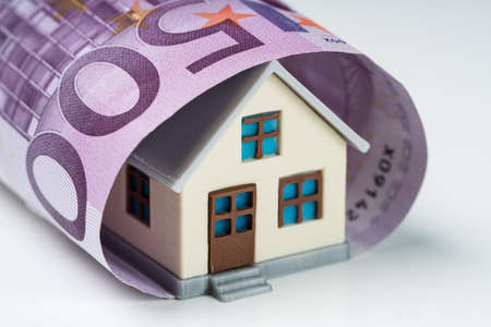 Close-up Of 500 Euro Note Covered With Miniature House Against White Background Stock fotó - 133705074