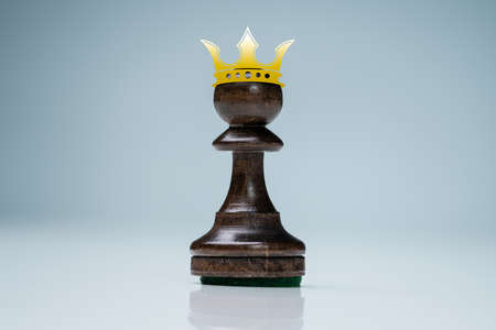 Pawn Wearing Crown. Success And Achievement Concept