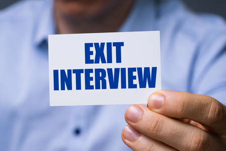 Man Showing Card With Exit Interview Text