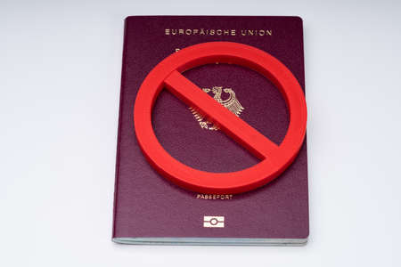 Elevated View Of Forbidden Sign On Red Passport Over White Desk Stok Fotoğraf - 133771656