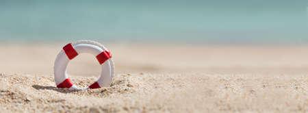 Panoramic View Of Single Lifebuoy On Sand At Beach