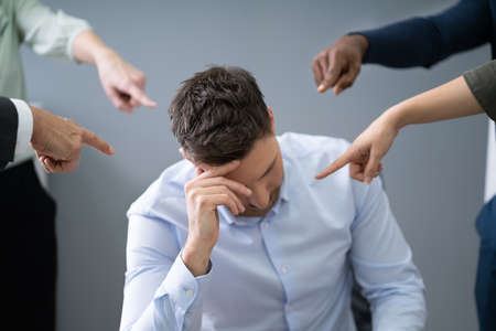Many Hands Pointing The Stress Businessman At The Workplace Stock Photo