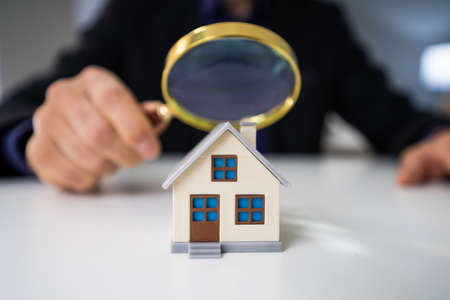 Close-up Of A House Model Seen Through Magnifying Glass On Table Imagens
