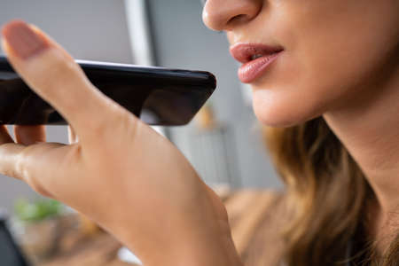 Close-up Of An Woman Using Voice Assistant On Cellphone Stock fotó