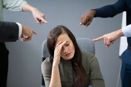 Many Hands Pointing The Stress Businesswoman At The Workplace