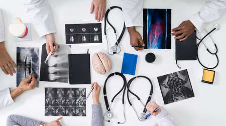 Doctors And Radiologists Discussing X-ray Images Of Patient