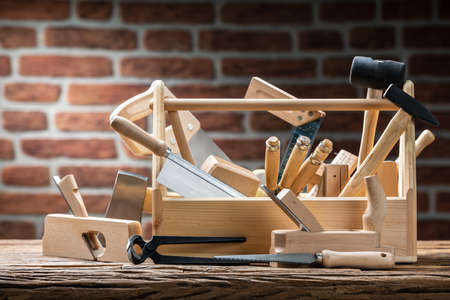 Toolbox With Carpenter Worktools Against Brick Background