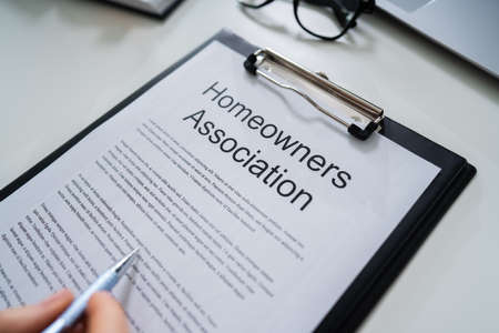 Person Reading HOA Rules And Regulations Document