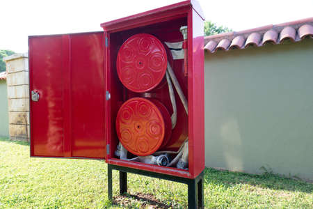Fire Hose Reel Outdoors. Fire Safety Concept