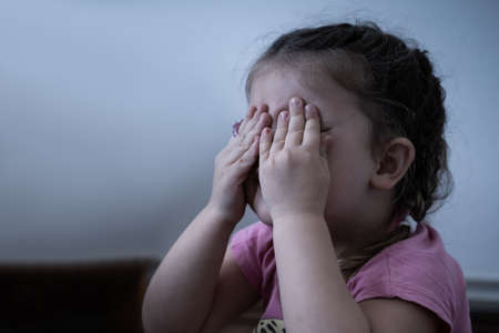 Little Girl Crying. Very Sad Girl Covering Her Eyes