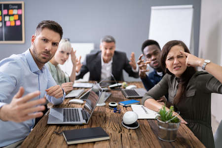 Group Of Business Executives Complaining Toward Camera In Office Stock fotó