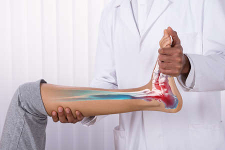 Close-up Of A Physiotherapist Giving Exercise On Womans Foot