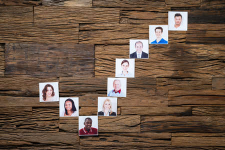 Checkbox Icon Made From People Photos On Wooden Desk Stock Photo