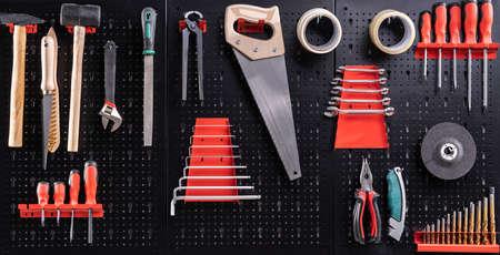 Toolkit Tools On Metal Board In Garage