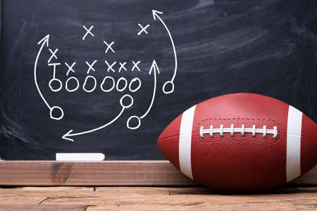 Football Play Strategy Drawn Out On A Chalk Board With Rugby Ball Banco de Imagens