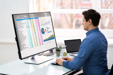 Professional Young Businessman Working On Computer In Office