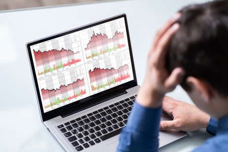 Despairing Businessman Faced With Stock Market Financial Losses