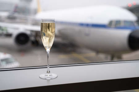 Champagne Glass In Airport Before Boarding Airplane Flight