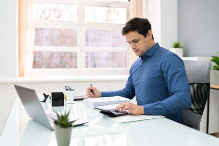Successful Accountant Working With Financial Data In The Office Stock Photo
