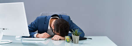 Photo Of Tired Businessman Sleeping In Office Stock Photo