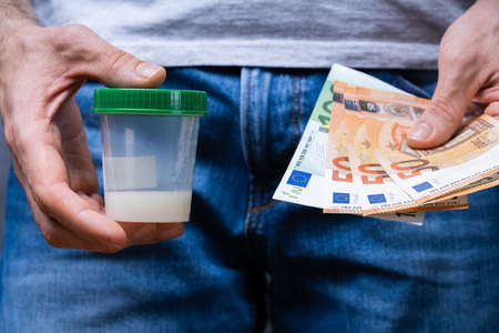 Sperm Donor Holding Container And Euro Money Notes