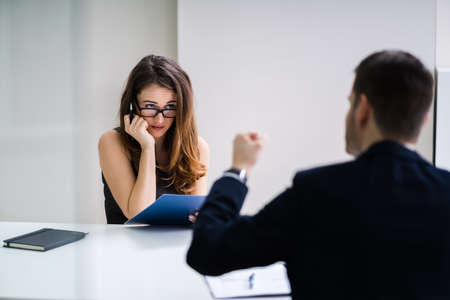 Boss With Clipboard Blaming To The Female Employee For Bad Results
