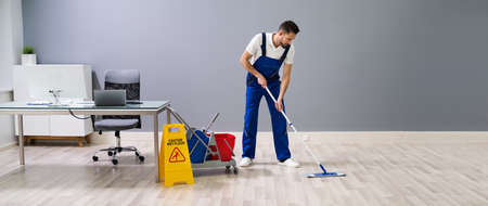 Man With Mop And Wet Floor Sign