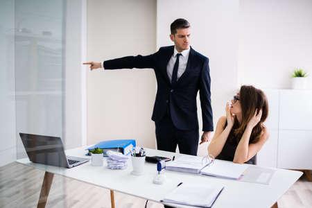 Boss Firing Female Employee In Modern Office