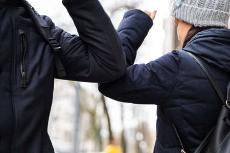 People Doing Elbow Arm Bump To Prevent Covid-19 Virus Spread 스톡 콘텐츠