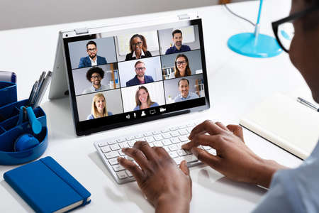 Woman Working From Home Having Group Videoconference On Laptop Standard-Bild