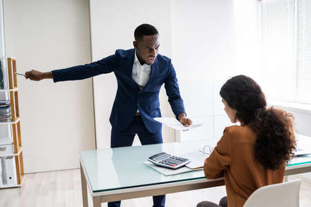 Boss Firing Female Employee In Modern Office