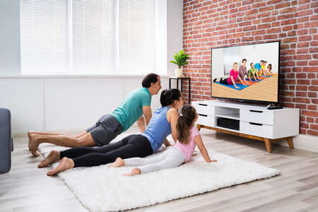Fit Family Doing Home Online Fitness Exercise New TV
