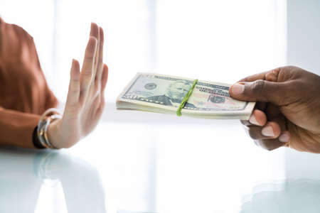 Woman Hand Refusing Bribe Given By Partner At Workplace