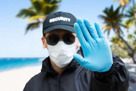 Security Guard Making Hand Stop Gesture At The Beach