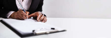 African American Woman Filling Business Contract Form