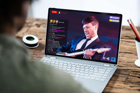 Streaming Live Music Video With Singer On Laptop Computer