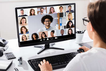 Woman Working From Home Having Online Group Videoconference On Laptop