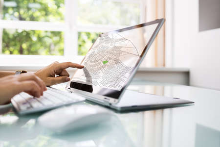 Female Executive Looking At Cadastre Map On Screen