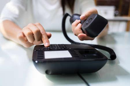 Businesswoman Hand Making Landline Telephone Call Pressing Button